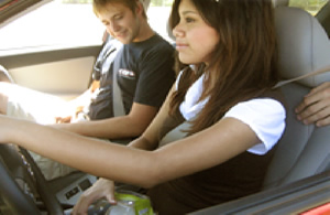 image of two teens in a car with their seat belts on