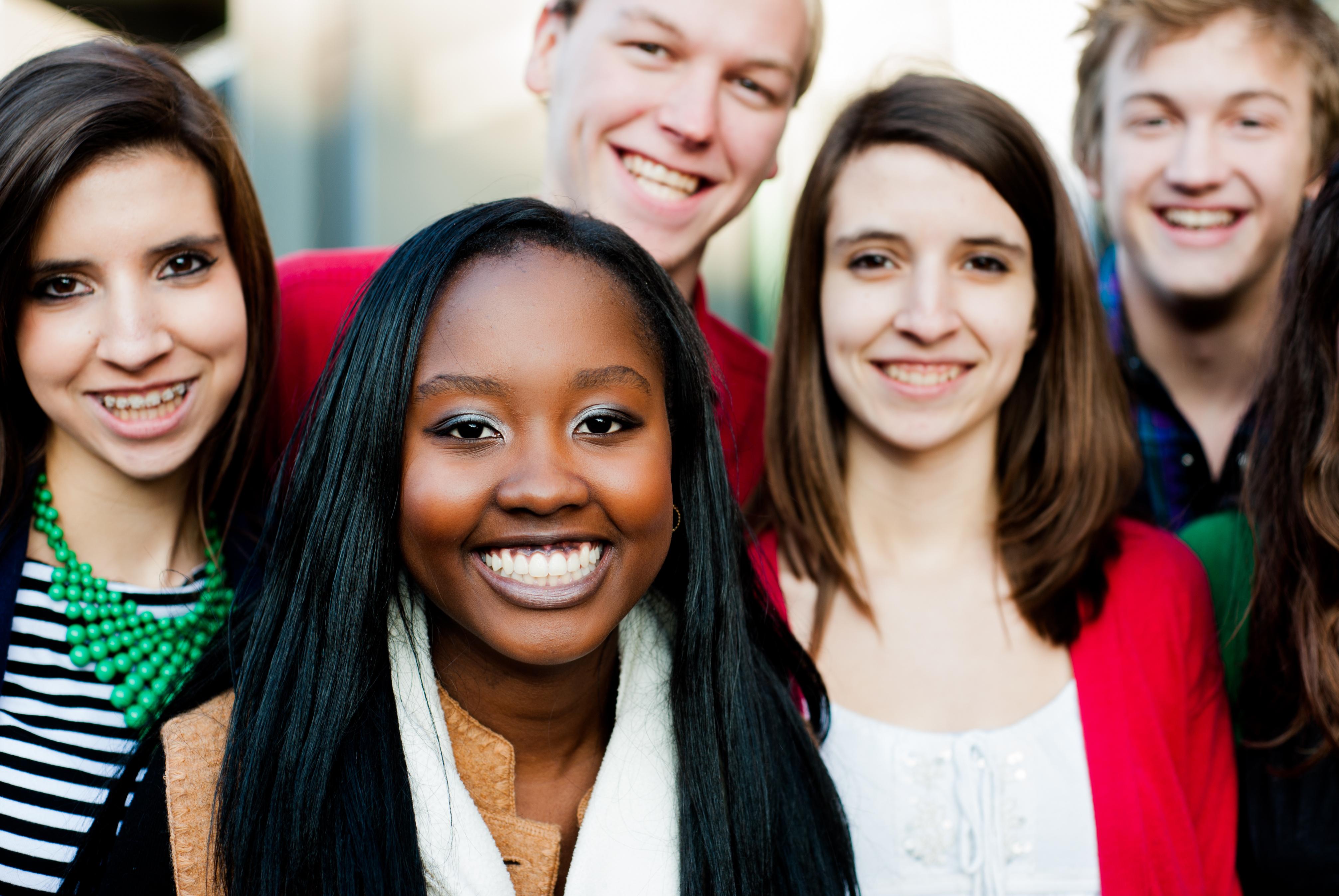 A group of teens huddled together