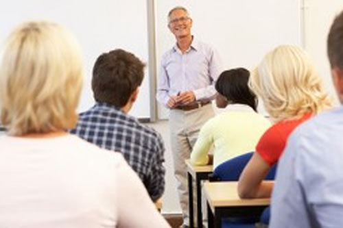 an image of adults taking a DUI class in a classroom